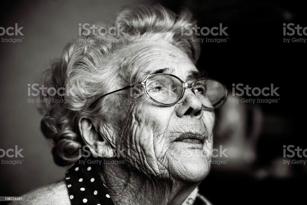 Portrait of Senior Woman Wearing Glasses, Black and White royalty-free stock photo