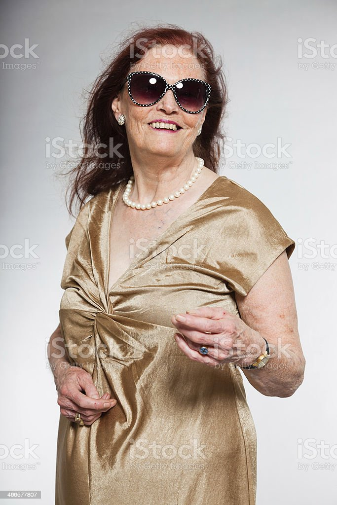 Portrait of senior woman with sunglasses showing emotions. royalty-free stock photo