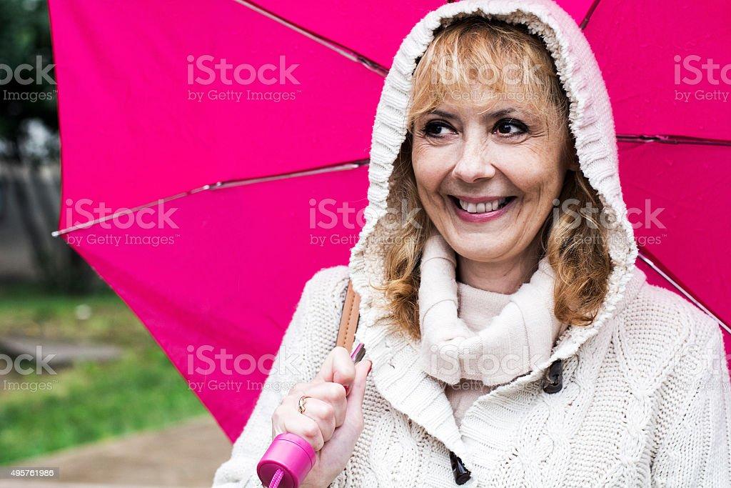 Portrait of senior woman with umbrella stock photo