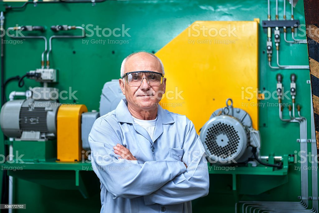 Portrait Of Senior Worker In Factory stock photo