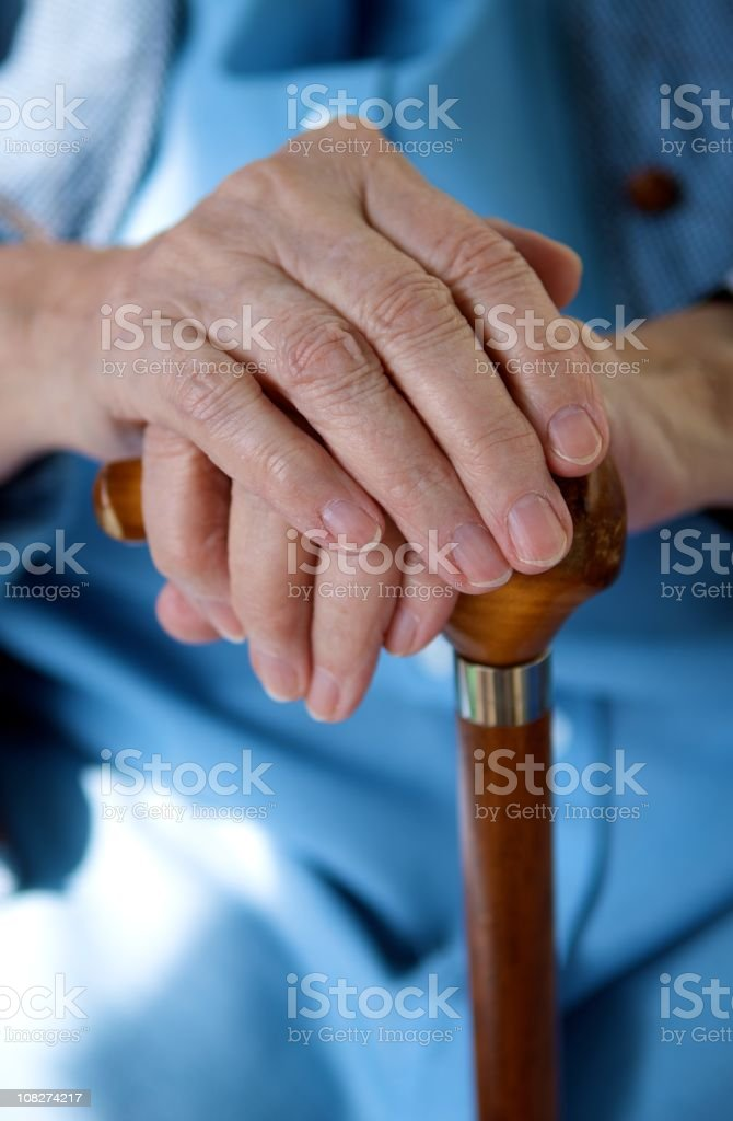 Portrait of Senior's Hands on Cane royalty-free stock photo