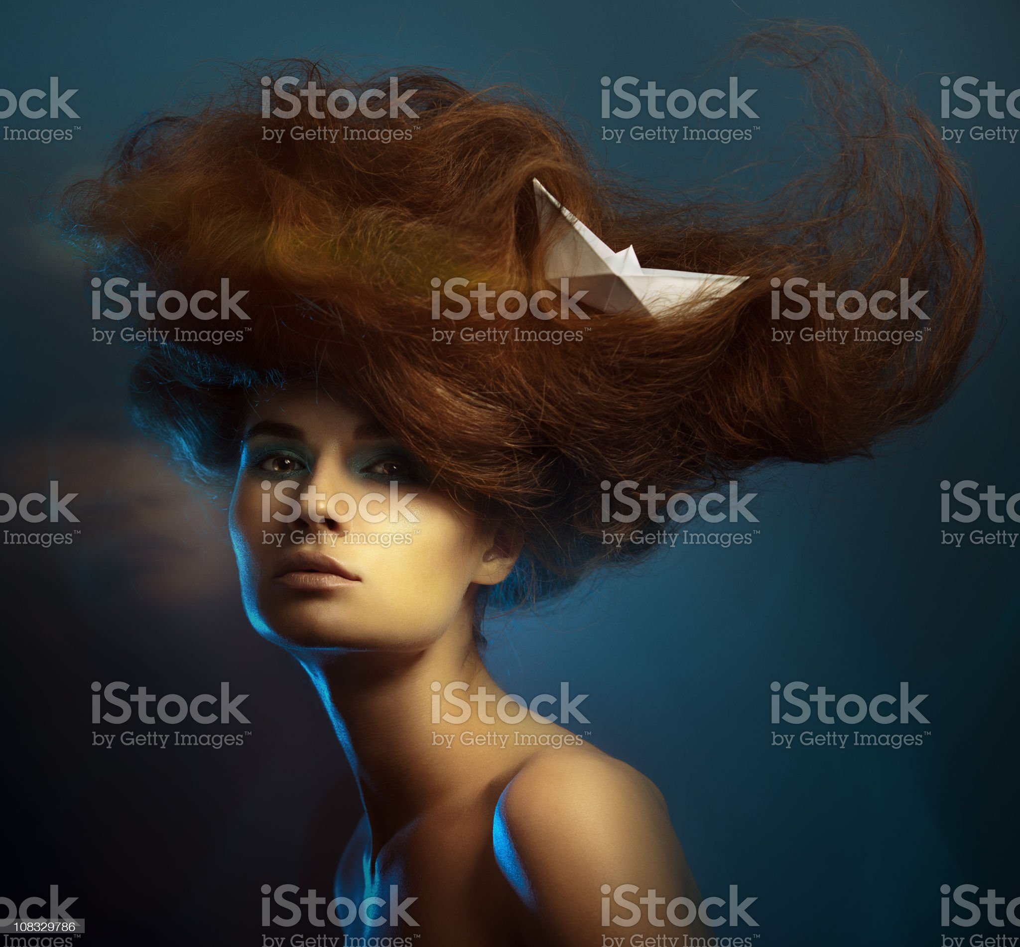 Portrait of sensual young woman on dark blue background. royalty-free stock photo