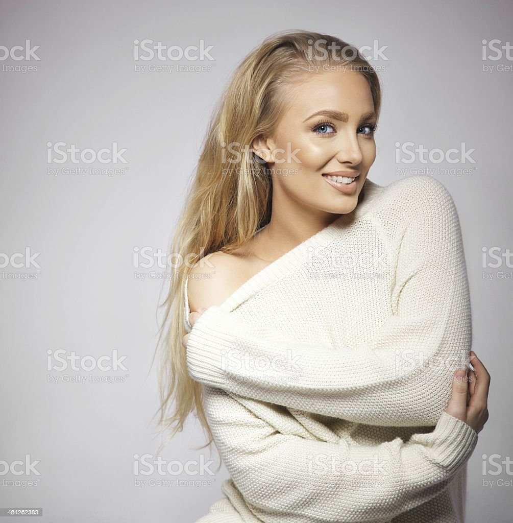 Portrait of sensual young woman posing on grey background stock photo