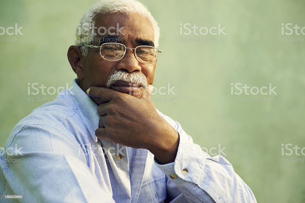 Portrait of serious african american old man looking at camera stock photo
