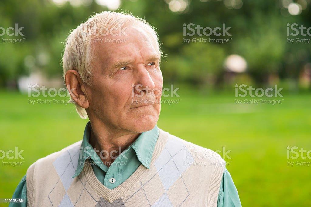 Portrait of serious elderly man. stock photo