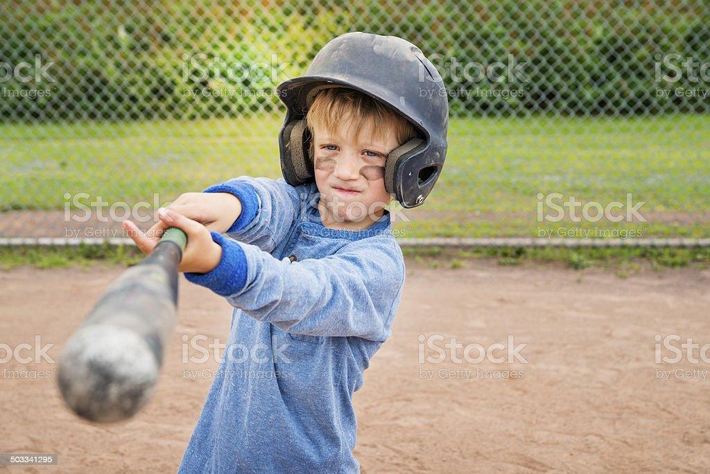 Portrait of serious little boy playing baseball. stock photo