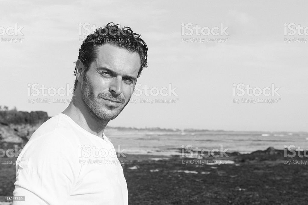 Portrait of Serious Man in 30s Beach Lifestyle Bali Indonesia stock photo