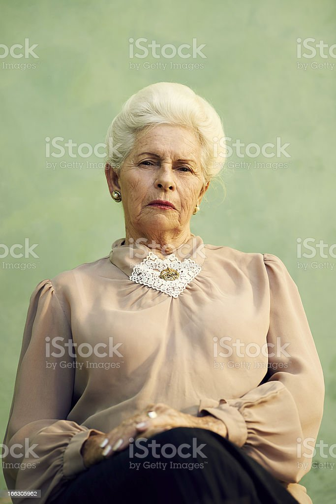 Portrait of serious old caucasian woman looking at camera stock photo