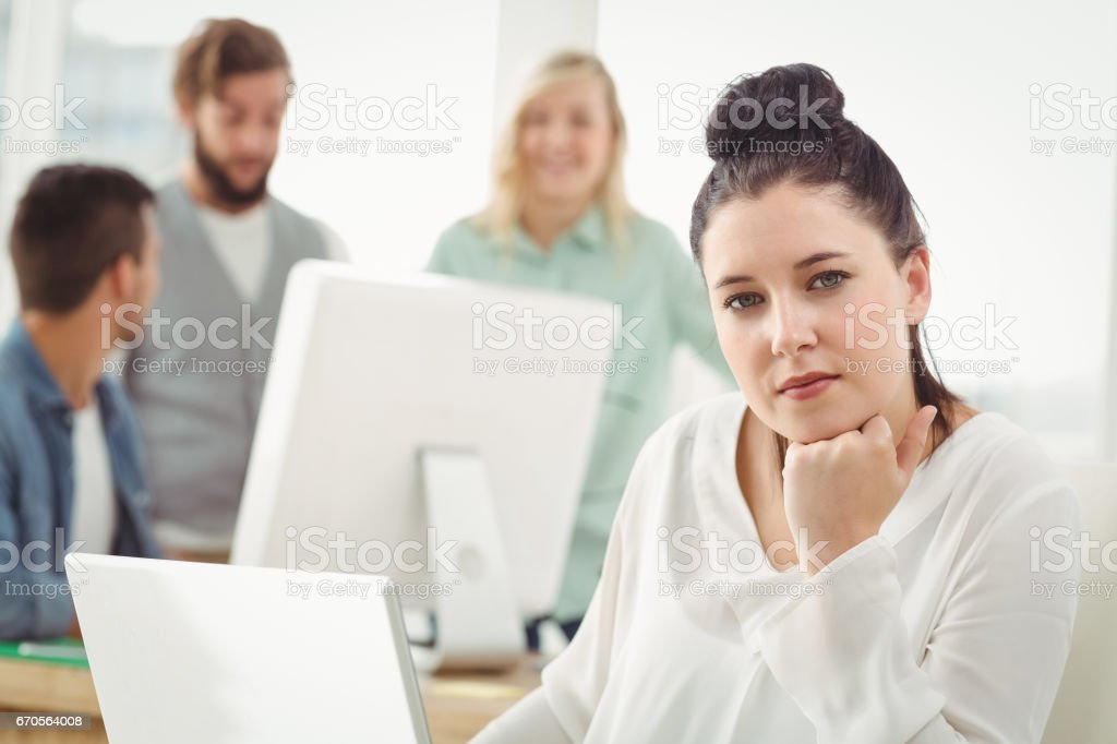 Portrait of serious woman with hand on chin royalty-free stock photo