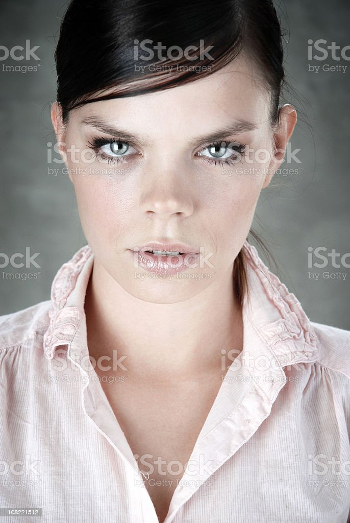 Portrait of Serious Young Woman Staring Ahead royalty-free stock photo