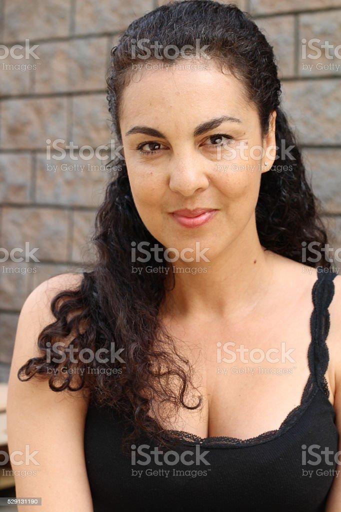 Portrait of sexy brunette mature woman stock photo