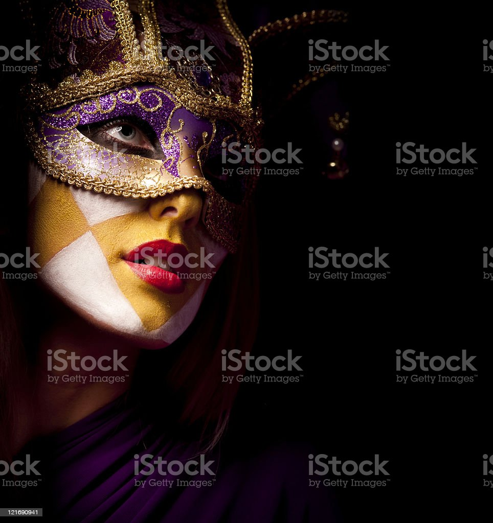 portrait of sexy woman in violet party mask stock photo