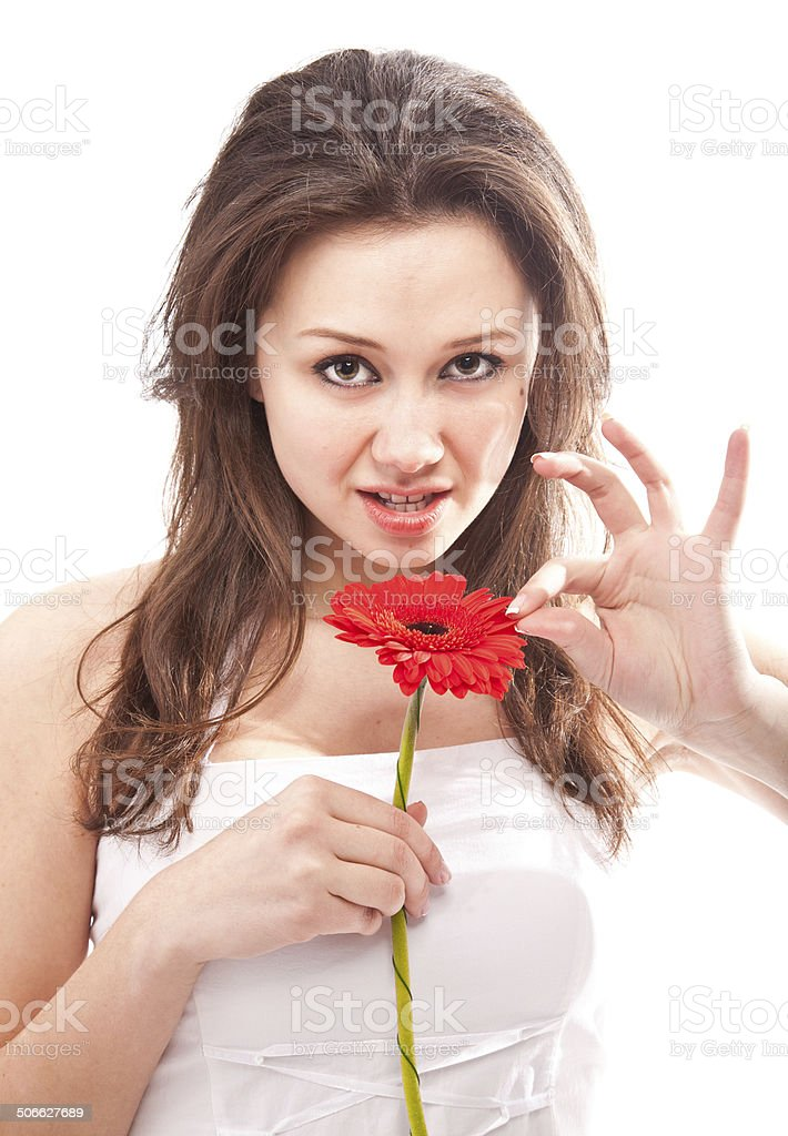 Portrait of sexy woman tearing petals of red flower stock photo