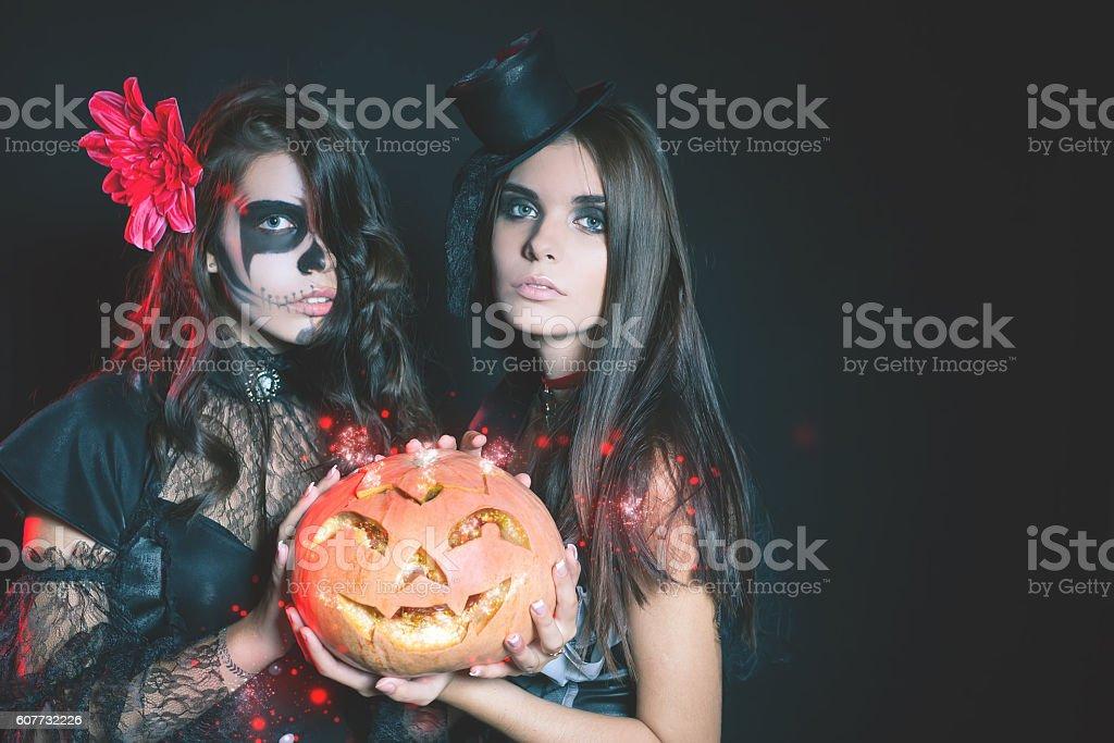 Portrait of sexy women with gothic makeup smokey eyes stock photo