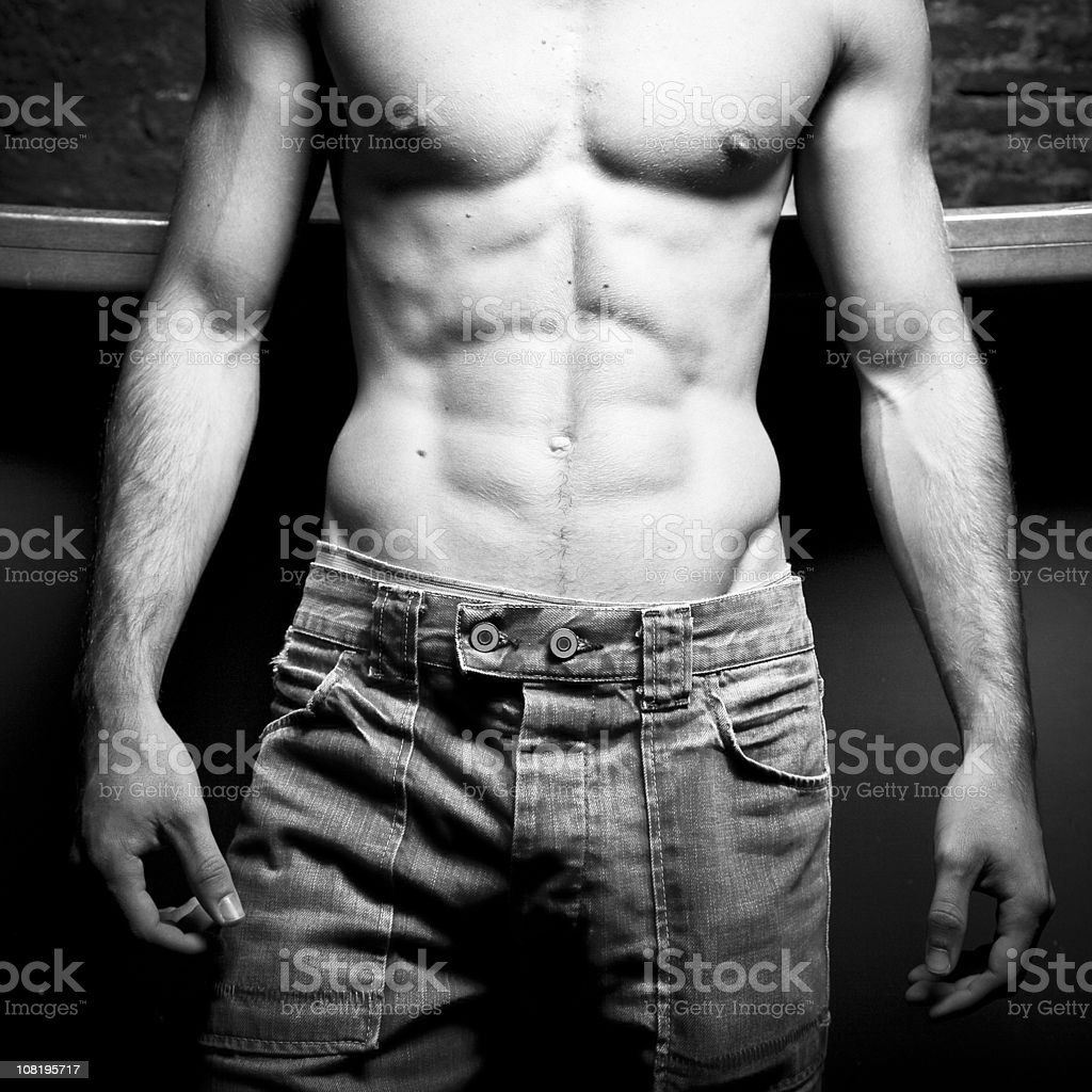 Portrait of Shirtless, Muscular Male's Chest, Black and White royalty-free stock photo