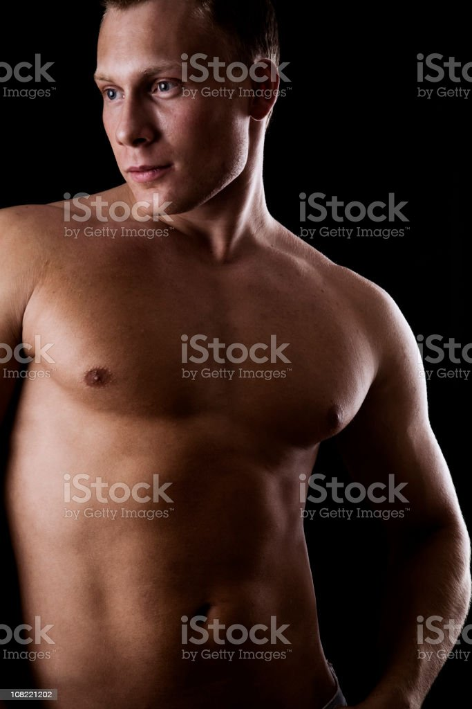 Portrait of Shirtless Young man on Black background royalty-free stock photo