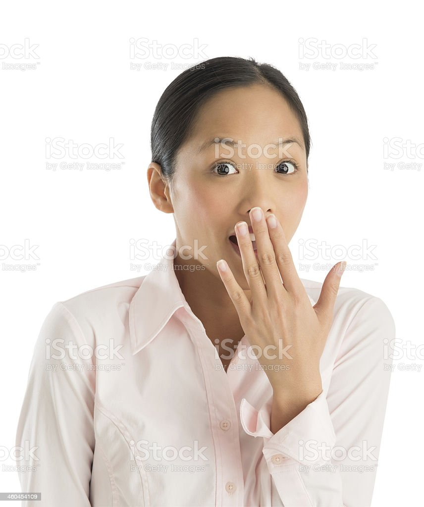 Portrait Of Shocked Young Businesswoman With Hand Over Mouth royalty-free stock photo