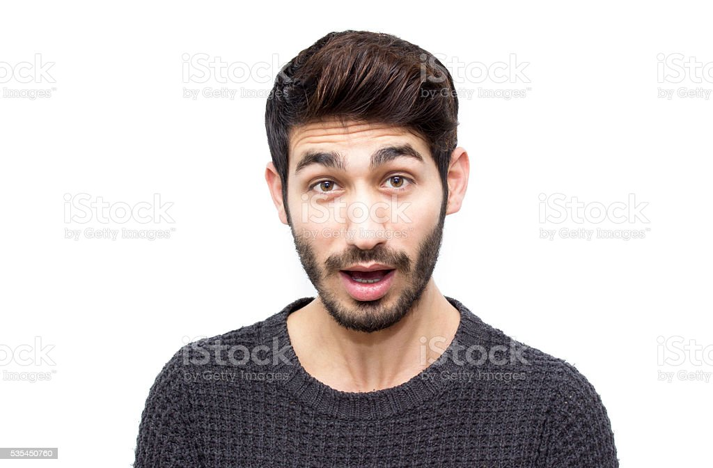 Portrait of shocked young man over white background stock photo