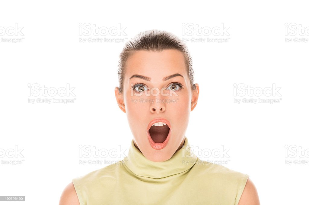 Portrait of shocked young woman making a face stock photo