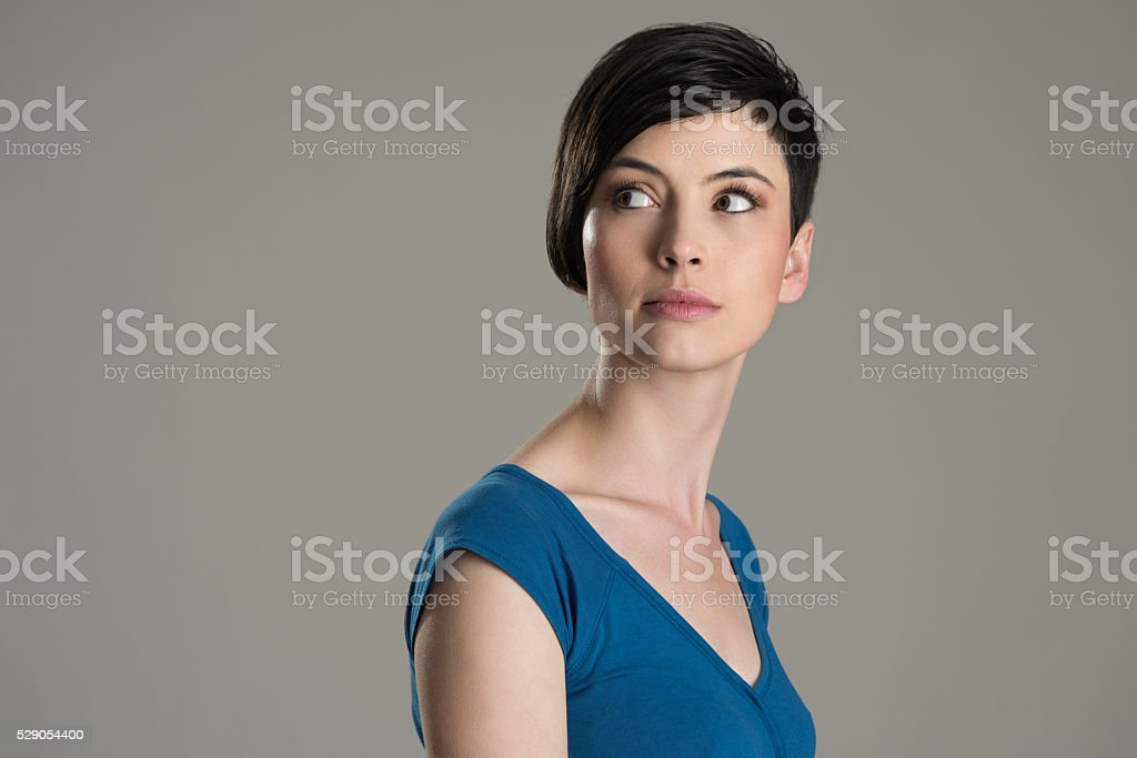 Portrait of short hair beauty looking back over the shoulder stock photo