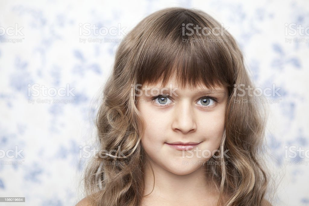 Portrait of sincere young grey-eyed girl child looking at camera royalty-free stock photo