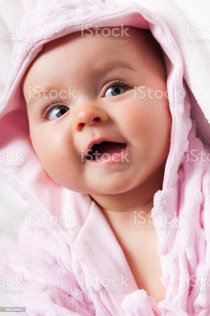 Portrait of six months old beautiful baby in pink bathrobe royalty-free stock photo