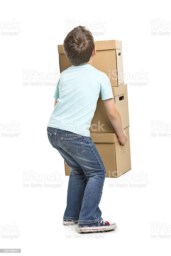 portrait of small boy with boxes royalty-free stock photo