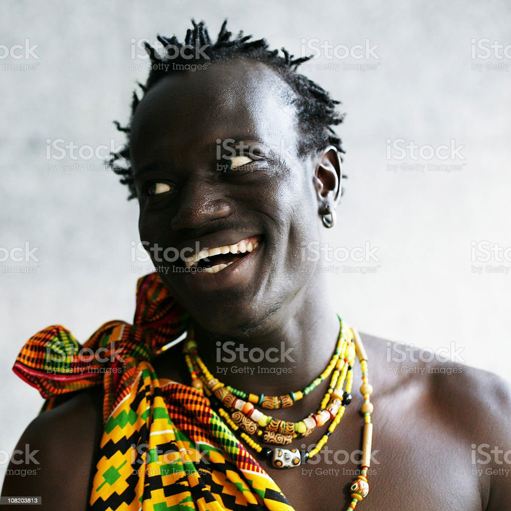 Portrait of Smiling African Man in Traditional Dress royalty-free stock photo