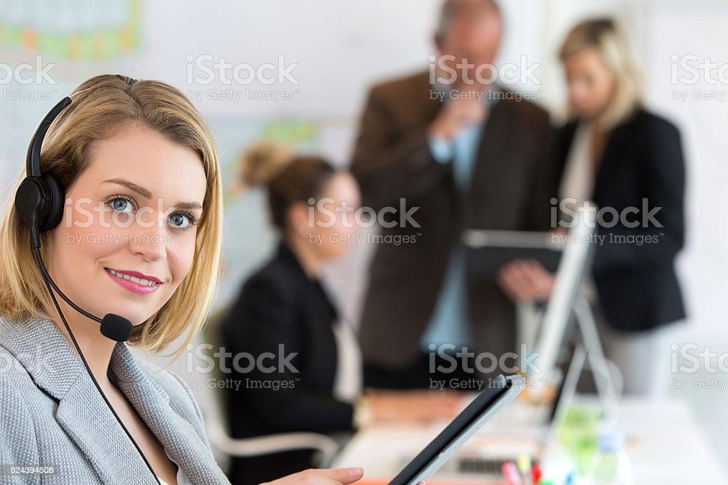 Portrait of smiling agent woman with headsets stock photo