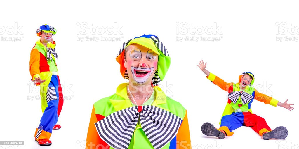 Portrait of smiling and fooling around animator in clown theater role. Emotional and colorful. Isolated background stock photo