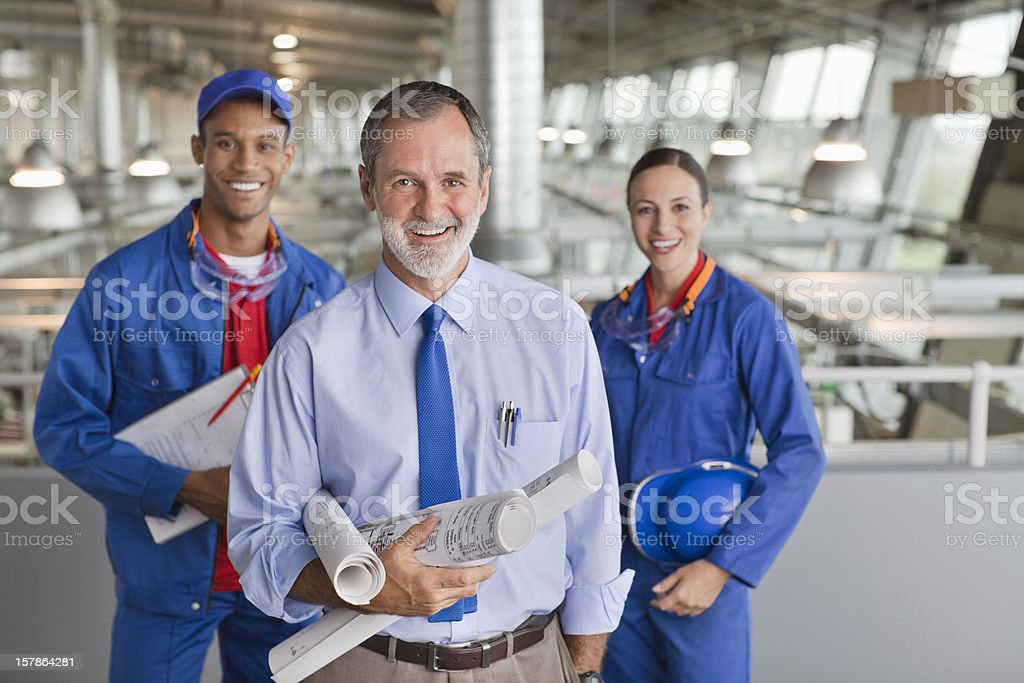 Portrait of smiling architect and workers stock photo