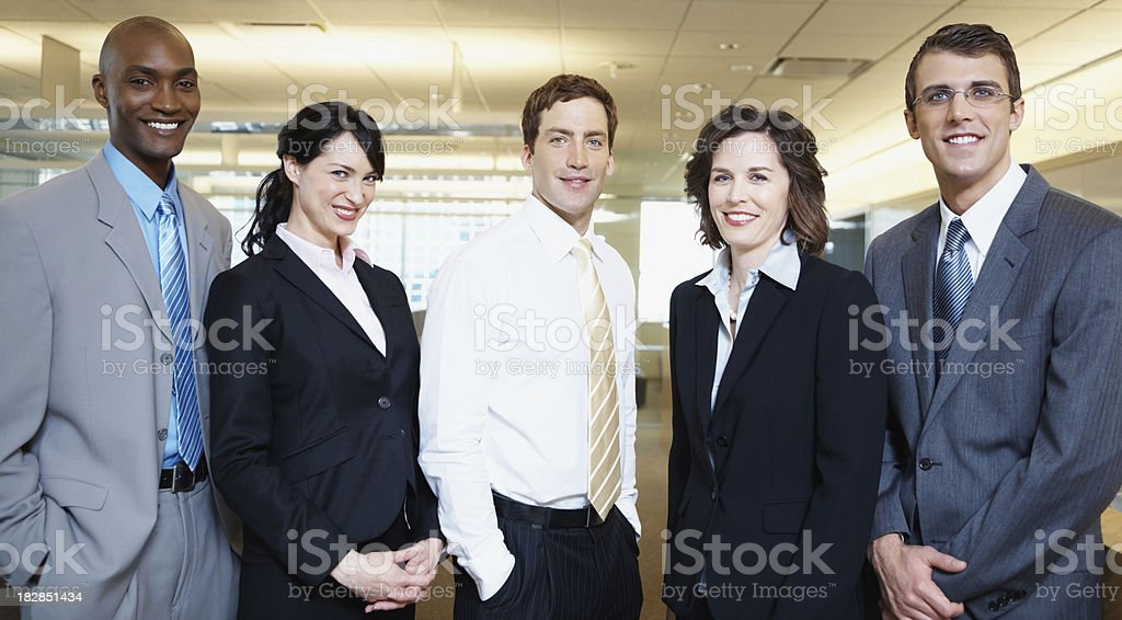 Portrait of smiling business executives standing in a group royalty-free stock photo