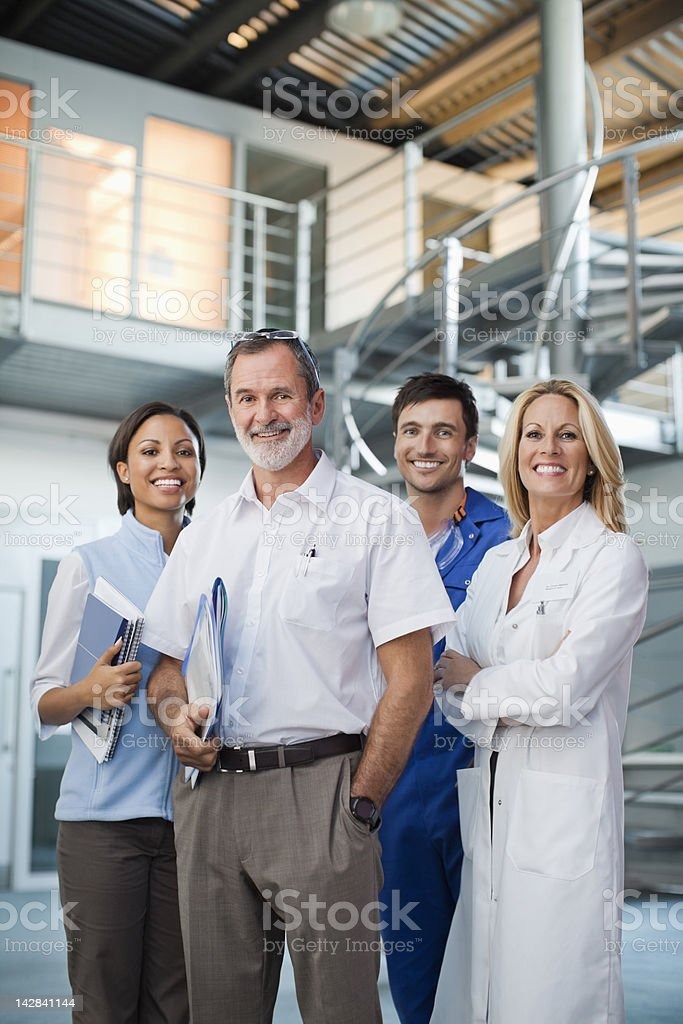 Portrait of smiling business people and scientist royalty-free stock photo