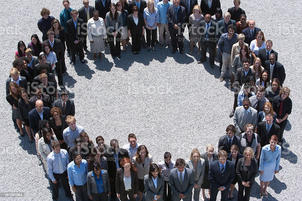 Portrait of smiling business people forming circle royalty-free stock photo