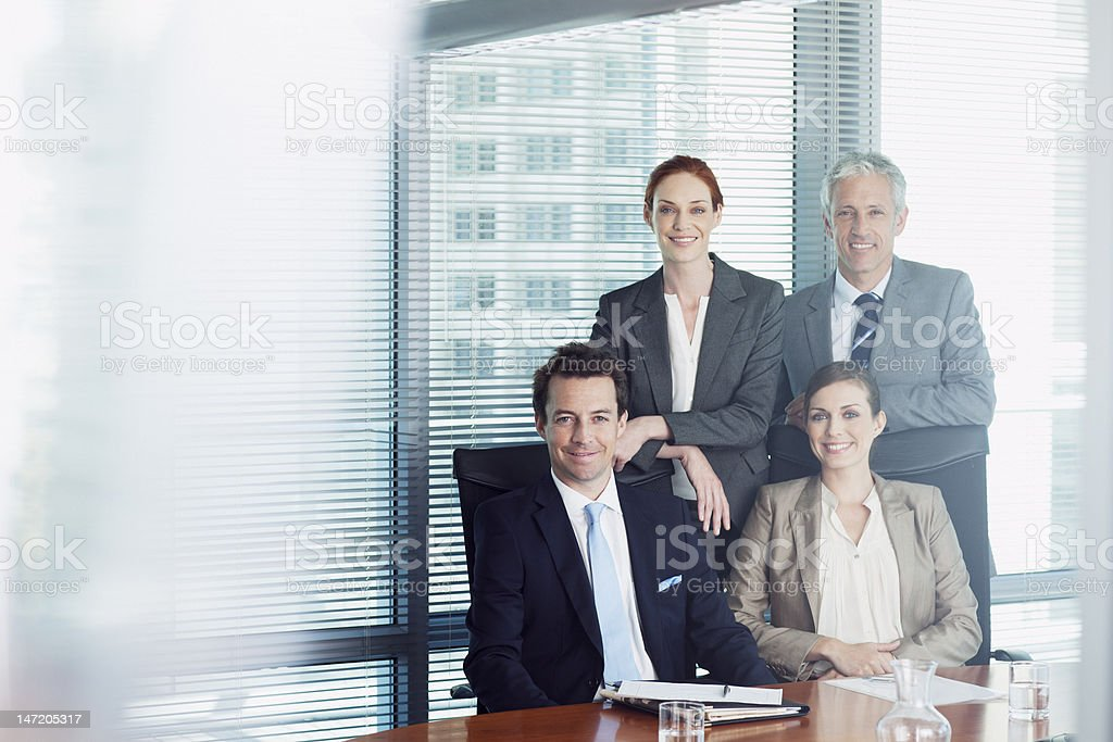 Portrait of smiling business people in conference room stock photo
