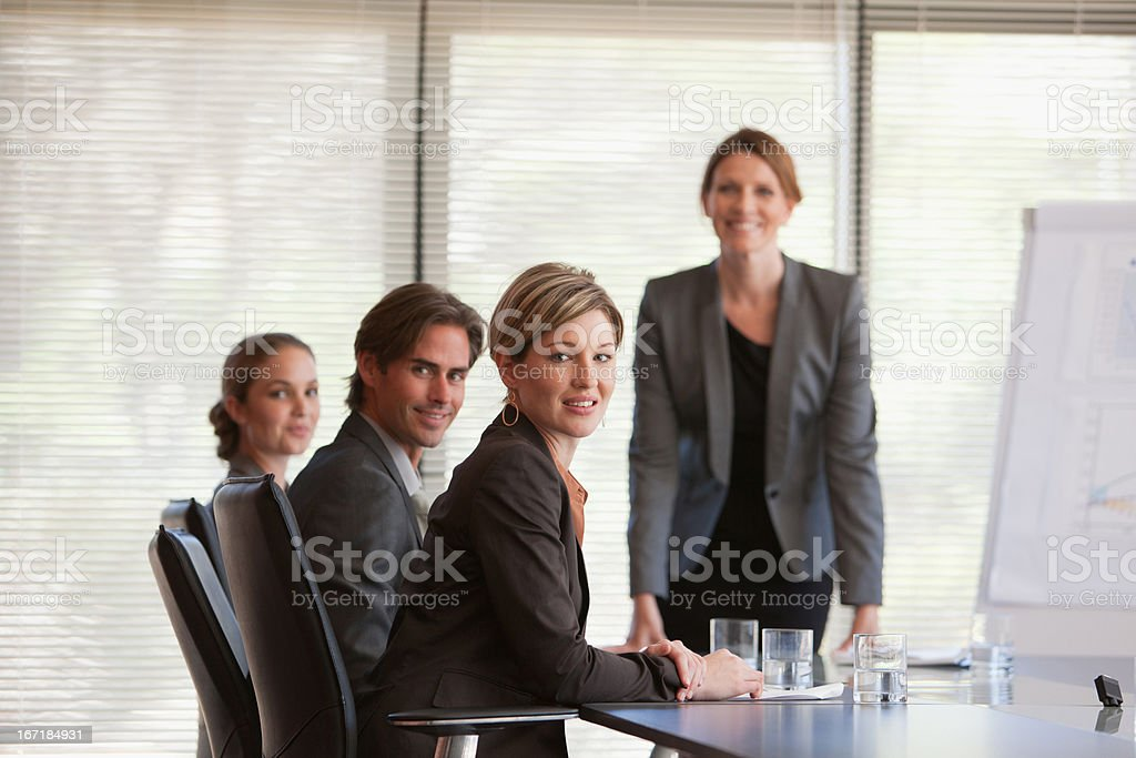 Portrait of smiling business people meeting in conference room stock photo