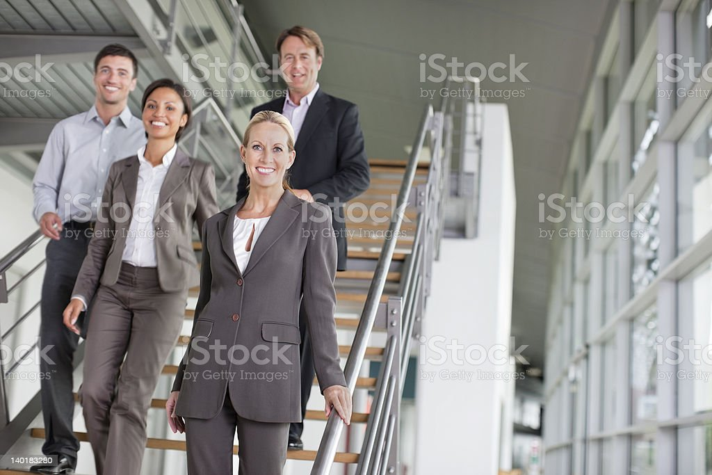Portrait of smiling business people on stairs royalty-free stock photo