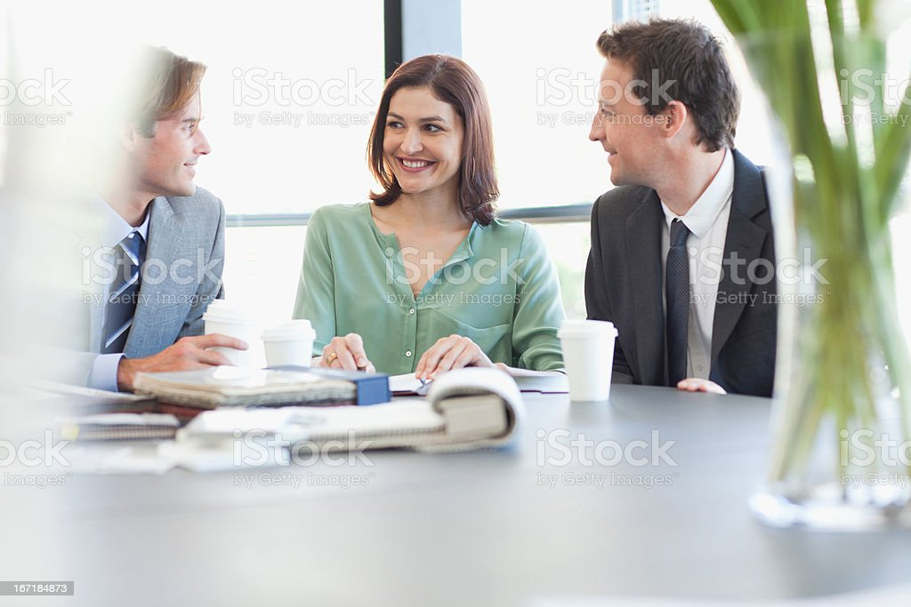 Portrait of smiling business people with coffee at table royalty-free stock photo