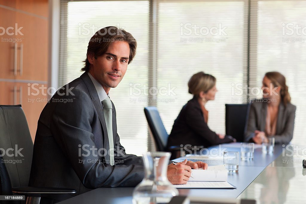 Portrait of smiling businessman in conference room stock photo