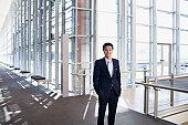 Portrait of smiling businessman in modern lobby