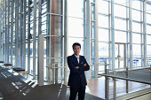 Portrait of smiling businessman in modern lobby