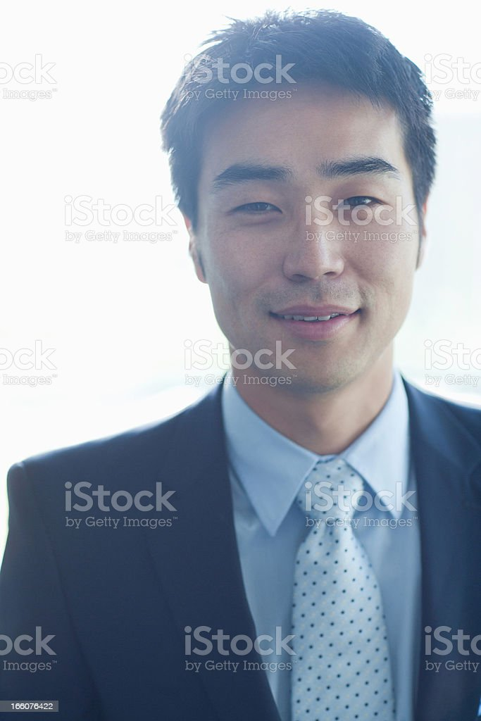 Portrait of smiling businessman in modern lobby royalty-free stock photo