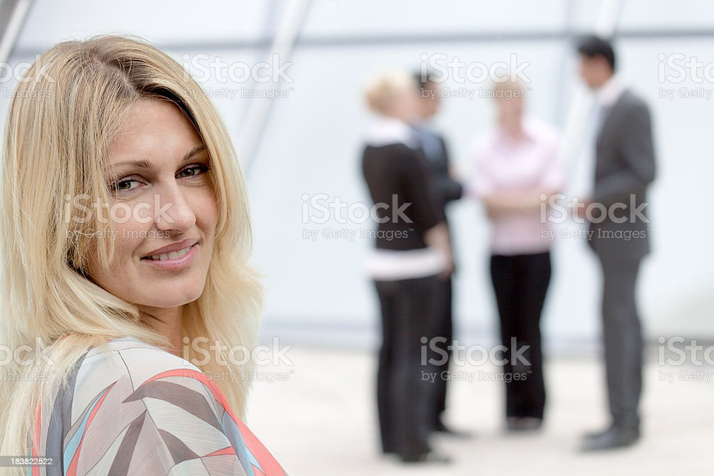 Portrait of smiling businesswoman with business team (XXL) royalty-free stock photo