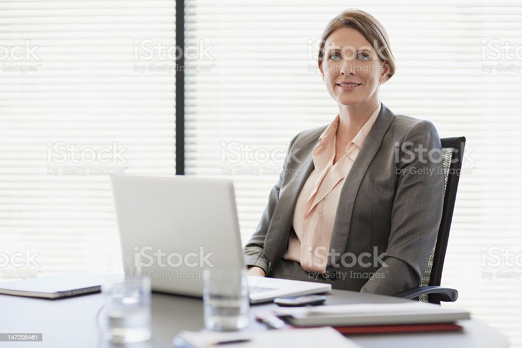 Portrait of smiling businesswoman with laptop royalty-free stock photo