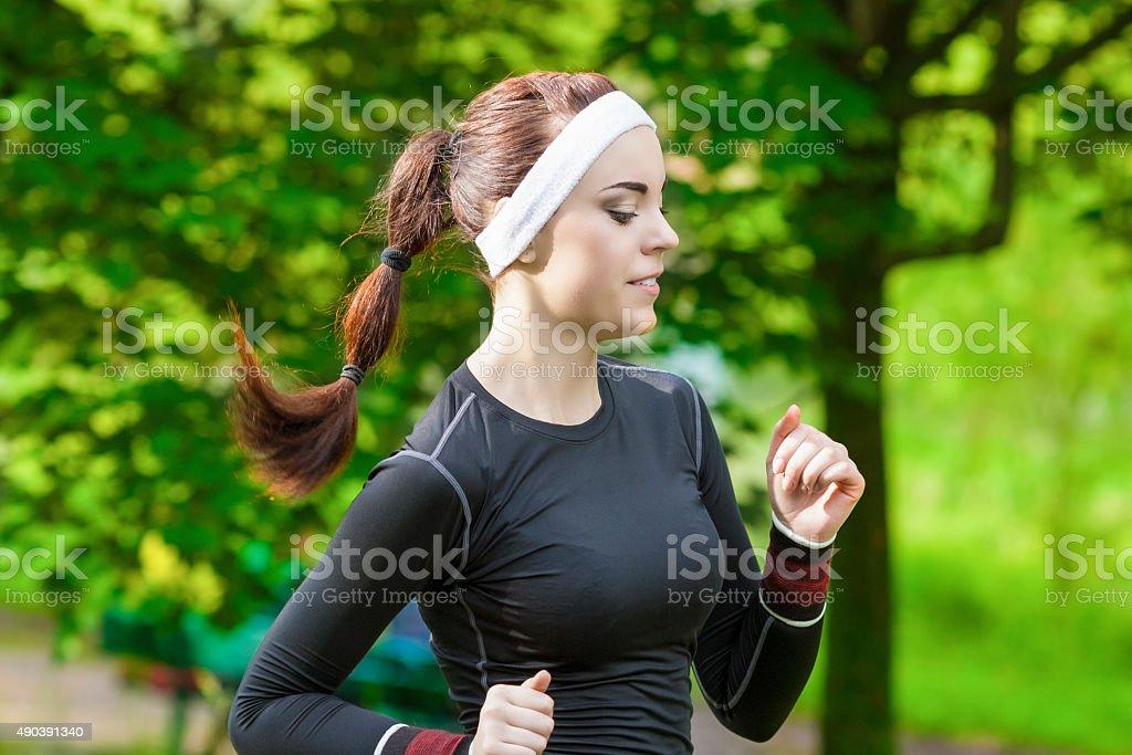 Portrait of Smiling Caucasian Sportwoman Having Her Regular Training Outdoors. stock photo