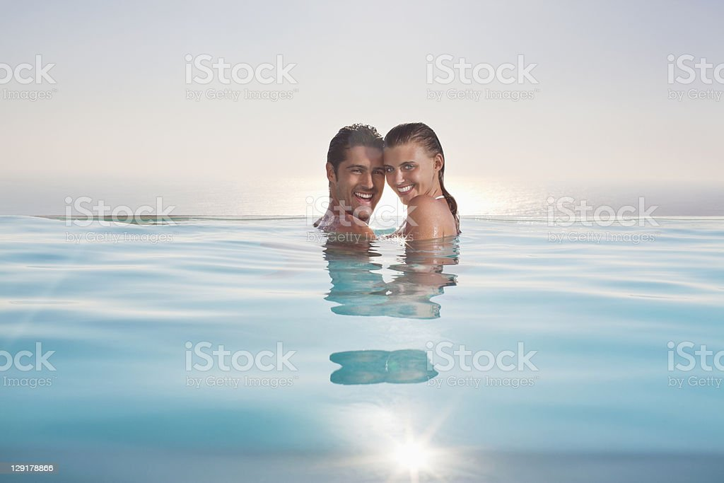 Portrait of smiling couple in pool royalty-free stock photo