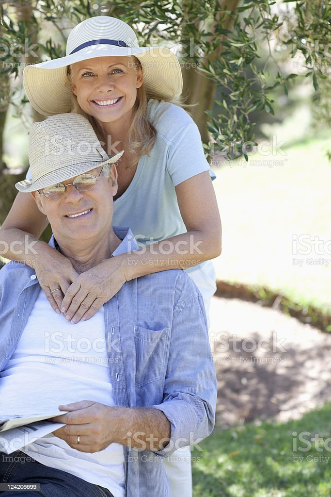 Portrait of smiling couple in the park royalty-free stock photo
