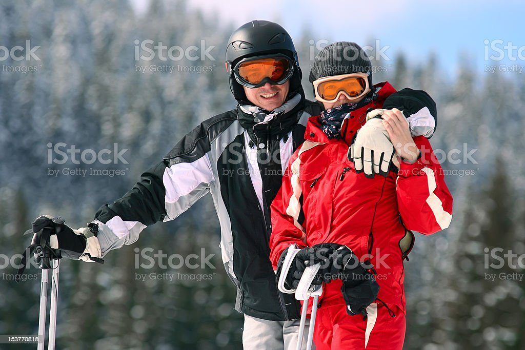 Portrait of smiling couple on skis royalty-free stock photo