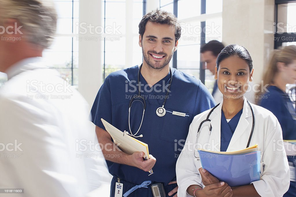 Portrait of smiling doctor and nurse in hospital royalty-free stock photo
