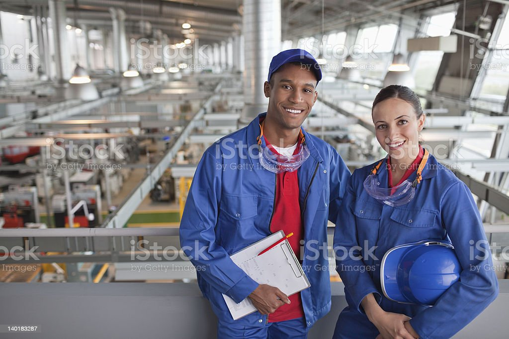 Portrait of smiling factory workers stock photo
